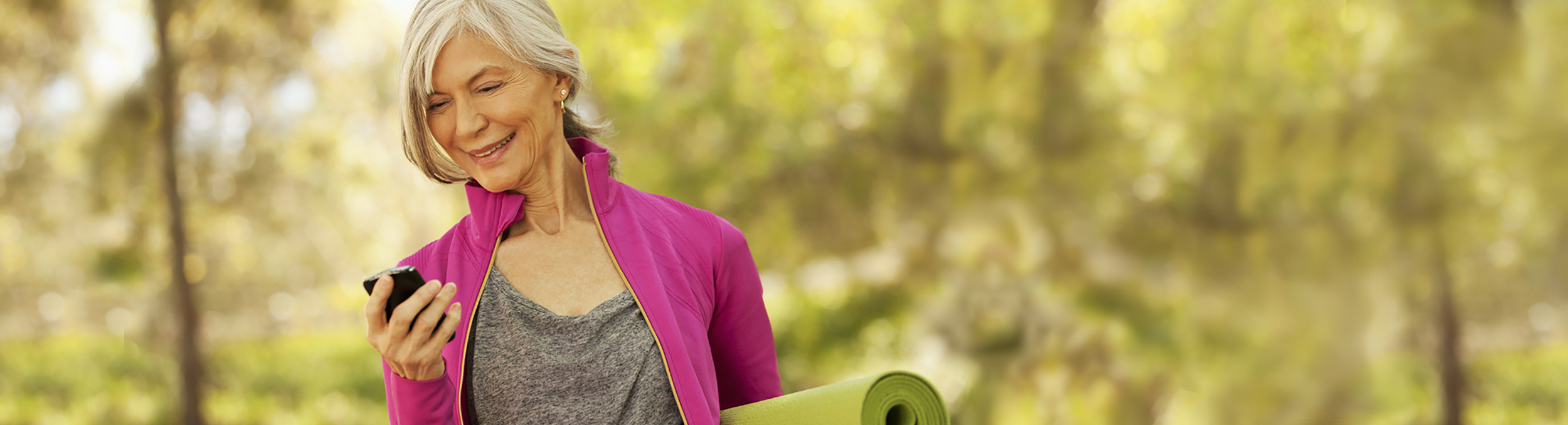 MyAgileLife_web banner_2500x679_Senior Woman w Yoga Mat on Phone